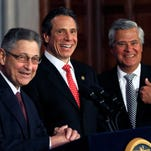 Former Assembly Speaker Sheldon Silver, D-Manhattan, left, Gov. Andrew Cuomo, center, and former Senate Majority Leader Dean Skelos, R-Rockville Centre, were all smiles during a 2012 news conference at the Capitol. Skelos and Silver have since been convicted on federal corruption charges.