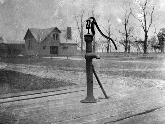It's believed this photo of the actual town pump and School 7 in the hamlet of Town Pump in the town of Ogden was taken around 1910.