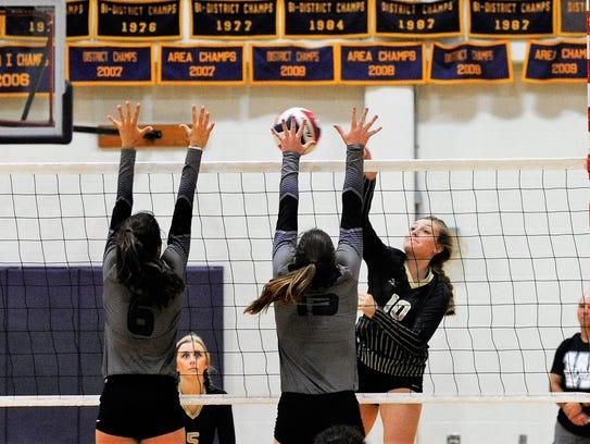 Abilene High's Saige McCray tries to split a Wylie