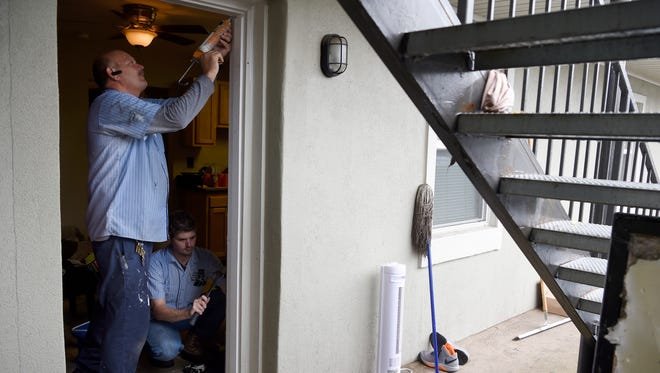 Apartment landlords must make emergency repairs if essential services are interrupted, but Tennessee law doesn't specify what counts, experts say. In this file photo from September, flooding damage is being repaired.