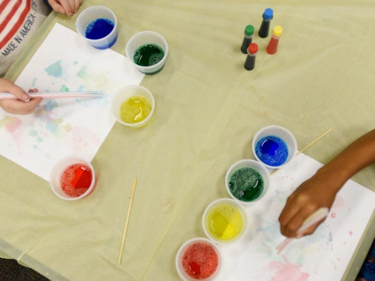 Kids paint in an art class at the Shreve Memorial Library