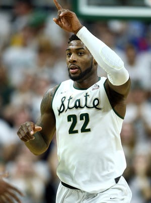 Michigan State forward Branden Dawson reacts to a play against Ohio State.