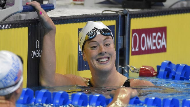 Allison Schmitt smiles after her heat in the women's 200-meter freestyle preliminaries at the U.S. Olympic swimming trials, Tuesday, June 28, 2016, in Omaha, Neb. (AP Photo/Mark J. Terrill)