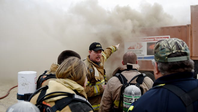State Fire Rescue instructor Mark Boaz (center) points out smoke indicators of a flashover phenomenon during a training session at the VFD Recruitment Day at the fairgrounds in this file photo. County officials are reminding people that if they didn't opt out of the new-for-2017 VFD fee, then they have to pay the $55 fee that is part of the tax bills arriving in mailboxes this week.