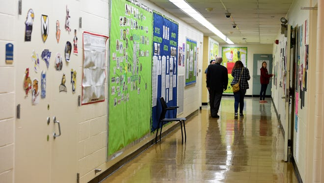 Students and staff use a hallway at the Excel Center on Tuesday, Aug. 16, 2016, in the former C.R. Richardson Elementary building in Richmond.