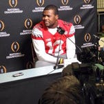 Ohio State quarterback Cardale Jones talks to reporters at the College Football Playoff Media Day in Dallas on January 10, 2015.