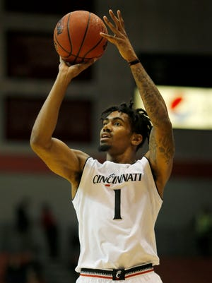 Cincinnati Bearcats guard Jacob Evans (1) shoots from 3-point range in the first half of the NCAA basketball game between the Cincinnati Bearcats and the Samford Bulldogs at Fifth Third Arena on UC's campus in Cincinnati on Wednesday, Nov. 23, 2016. At halftime, the Bearcats trailed 35-30.