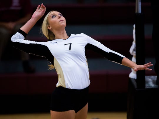 T.L. Hanna's Olivia Johnson spikes the ball at the T.L. Hanna vs. Westside volleyball game on Thursday, September 29, 2016 in Anderson.