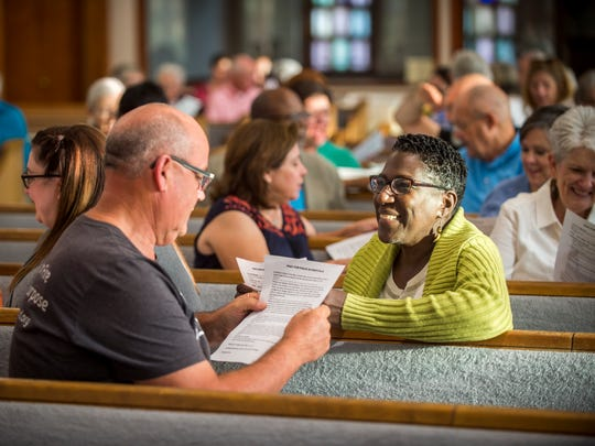 Attendees from area churches pray together during a prayer service for peace held at Second United Methodist Church on Friday, August 25, 2017, in response to a planned white supremacist rally and its counter protest in Knoxville.