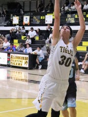 Alamogordo's Faith Silva attempts a layup. Silva finished with 32 points.