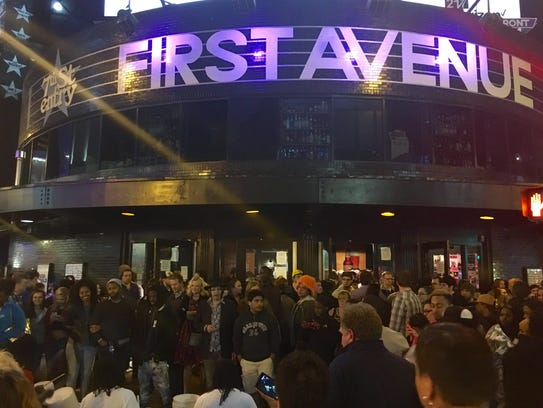 Crowds gather outside the Minneapolis club First Avenue,