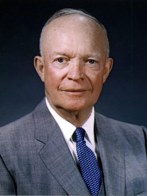 "President Dwight D. Eisenhower makes the phrase ""In God We Trust"" the national motto of the United States on July 30, 1956."