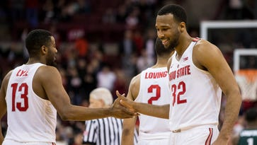 Ohio State Buckeyes center Trevor Thompson (32) and guard JaQuan Lyle (13) share a handshake near the end of the game against the Michigan State Spartans at Value City Arena. Ohio State won the game 72-67.