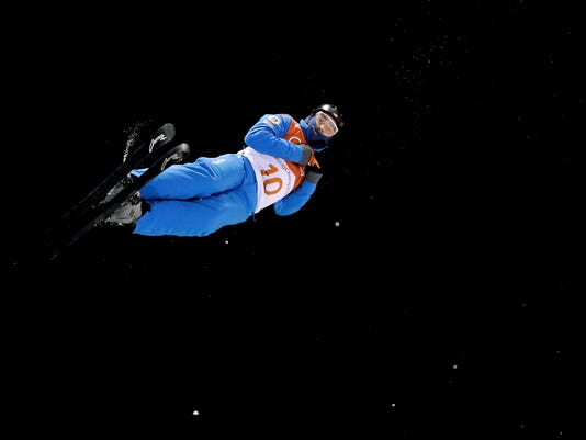 JonathonLillis, of the United States, jumps during a training run prior to the men's aerial final at Phoenix Snow Park at the 2018 Winter Olympics in Pyeongchang, South Korea, Sunday, Feb. 18, 2018. (AP Photo/Gregory Bull)
