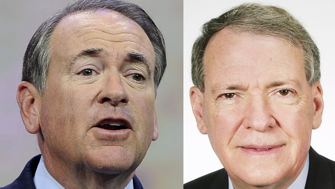 Republican presidential candidate Mike Huckabee, left, and former congressman Charles Taylor.