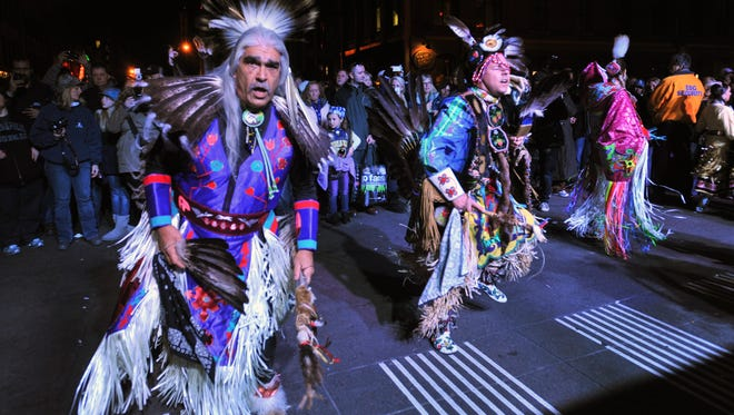 Members of the Pokagon Band of the Potawatomi from Michigan and Northern Indiana dance in front of the Pepsi Stage at Super Bowl Village Monday January 30, 2012.  Joe Vitti / The Star