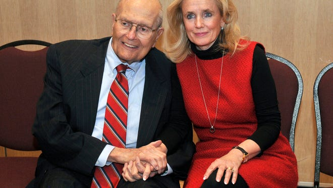 U.S. Rep. John Dingell, left, and his wife Debbie hold hands during a legislative forum at the Southern Wayne County Regional Chamber (SWCRC) at the Crystal Gardens in Southgate, Mich. on Monday, Feb. 24, 2014. John Dingell, the longest-serving member of Congress in American history and a champion of Detroit's auto industry, has announced his retirement. (AP Photo/Detroit News, Max Ortiz)  DETROIT FREE PRESS OUT; HUFFINGTON POST OUT ORG XMIT: MIDTN202