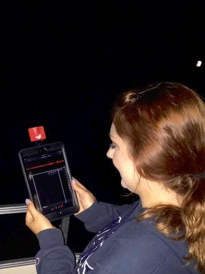 Woodland Dunes intern Julia Adams recording bats using an EchoMeter bat monitor.