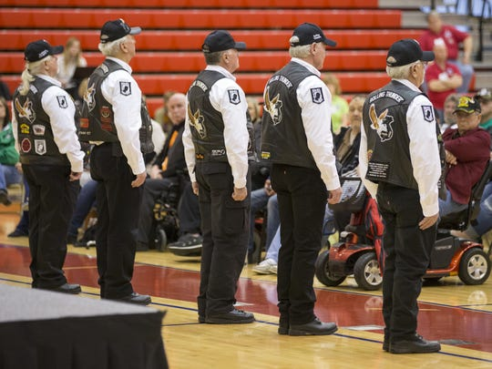 Members of Rolling Thunder stand in front of the audience during a roll call for the 50 missing Hoosier military members who have not made it home from Vietnam during a Welcome Home Vietnam Veterans celebration at Plainfield High School, Thursday, March 29, 2018.