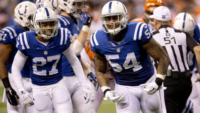 Indianapolis Colts linebacker Andrew Jackson (54) celebrates along side teammate Josh Gordy during the second half of an NFL wildcard playoff football game Sunday, Jan. 4, 2015, in Indianapolis. (AP Photo/AJ Mast)