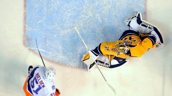 Predators goalie Pekka Rinne (35) allows a goal during the first period against the Islanders.