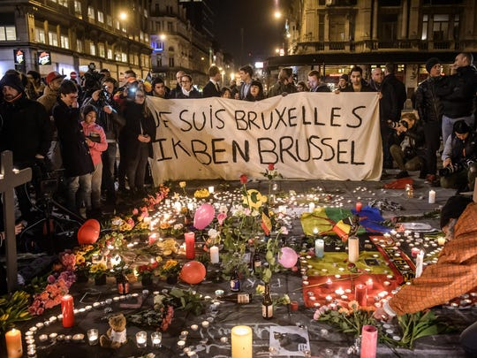 People gather at Bourse square to pay tribute to the victims of the terror attacks.