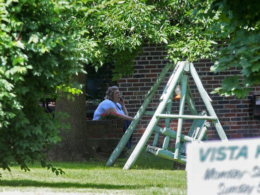 People remain on scene taking care of Vista Kennels business and aiding the investigation into the deadly home invasion Wednesday night in east Des Moines by Ngor Peter Makuey, who lived nearby Thursday, July 3, 2014.