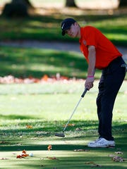 Union-Endicott's Caleb Macan putts on the 18th hole
