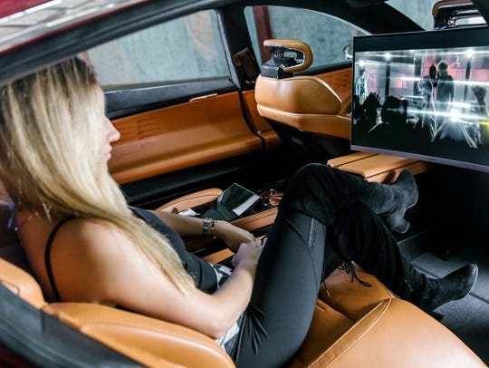 """Rear seat passengers in the EMotion electric sedan get the latest in entertainment systems, including an optional 27-inch curved monitor in the """"Chaffeur Edition"""" model."""