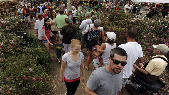 The crowd checks out the 35th Seafood Festival on Saturday at Seville Square. photos by John Blackie/jblackie@pnj.comThe crowd checks out the sites Saturday during the Fiesta of Five Flags Pensacola Seafood Festival at Seville Square.