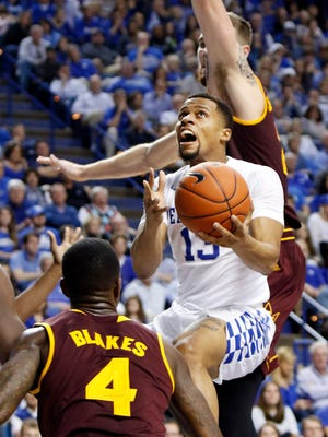 Kentucky's Isaiah Briscoe, middle, shoots between Arizona State's Gerry Blakes (4) and Eric Jacobsen during the second half of an NCAA college basketball game Saturday, Dec. 12, 2015, in Lexington, Ky. Kentucky won 72-58.