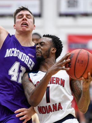 University of Southern Indiana's Jeril Taylor drives against McKendree's Darin Winkelman as USI plays McKendree University at the PAC Arena Saturday, February 18, 2017.
