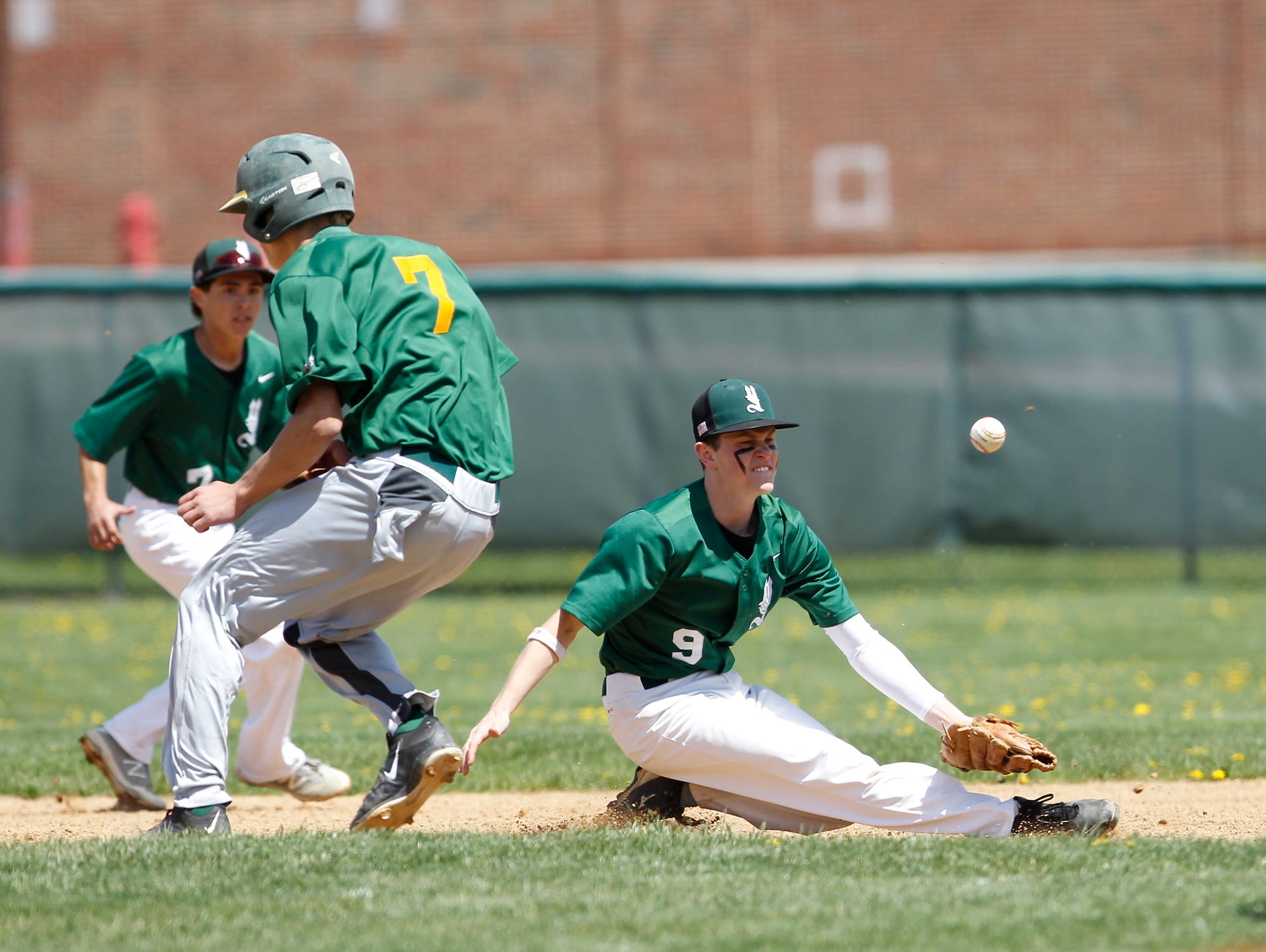Lakeland's Trevor McCarthy (7) is safe at second as Yorktown second baseman Trevor Boclan (9) reaches for the throw during a varsity baseball game in Yorktown High School on Saturday, April 23, 2016.
