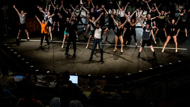The cast perform the opening number of 'A Chorus Line' during rehearsals a week before opening night. Weathervane is celebrating their 50th anniversary this summer.