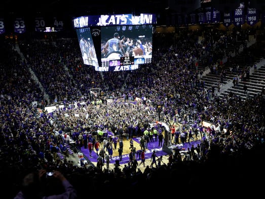 Kansas State fans rush the floor following an NCAA