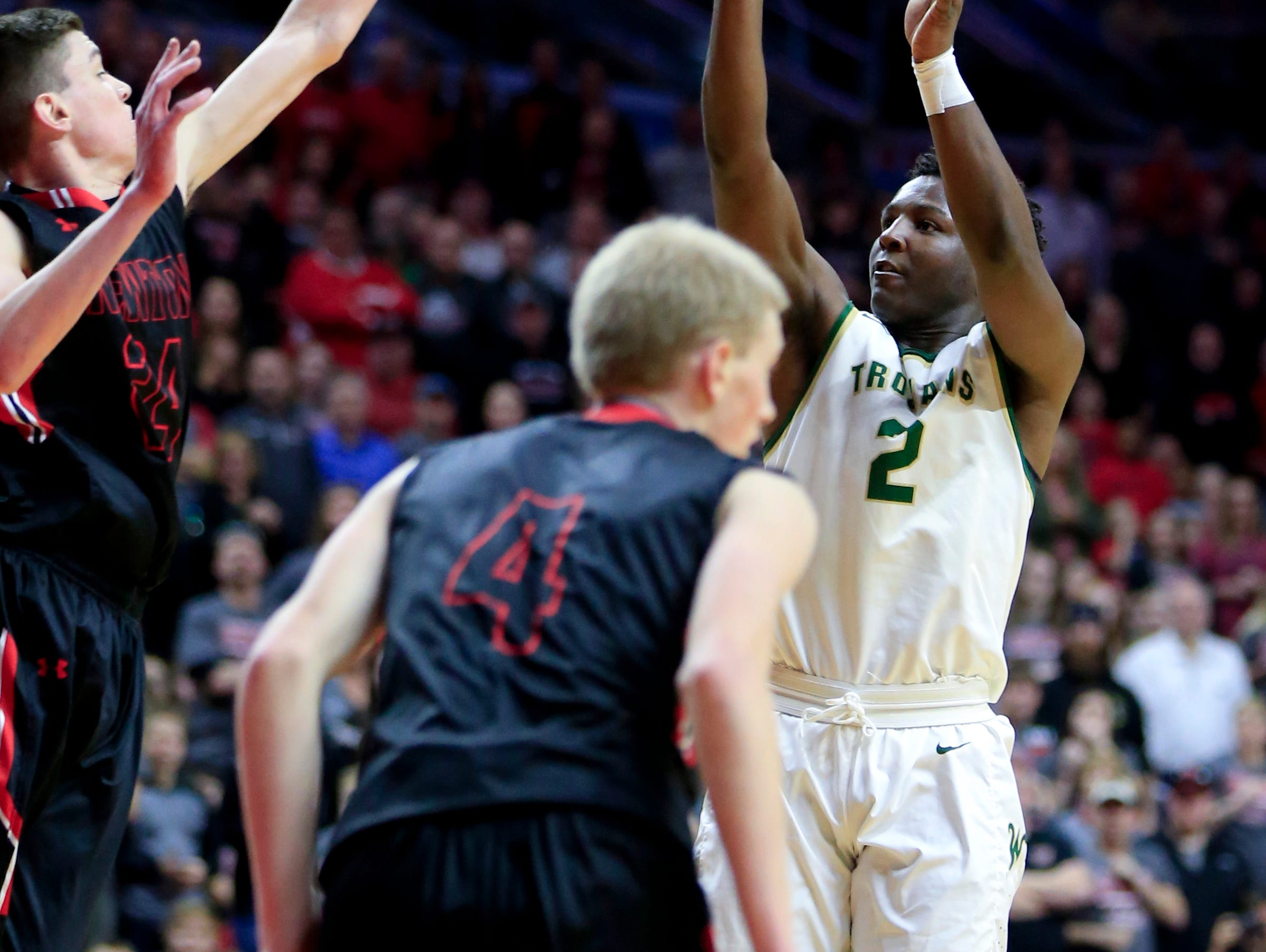 Devontae Lane of Iowa City West puts up a shot during the 4A quarter finals against Newton Wednesday, March 8, 2017.
