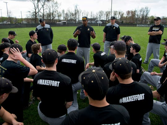 Boonville baseball coach Eric Barnes, top center, makes closing remarks after a joint-team hitting and conditioning practice Monday afternoon. The first-year coach preaches a focused message of not worrying about the things his team can't control (an umpire's strike-zone, for instance) and focusing on the things they can control (their attitudes).