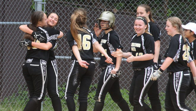 Clarkstown South players celebrate their 5-4 win over Ketcham in a Section 1 Class AA softball tournament first round game at Clarkstown South May 20, 2017.