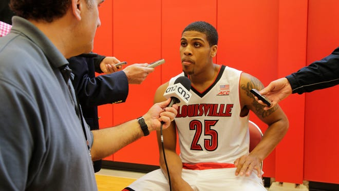 University of Louisville Cardinals forward Wayne Blackshear gets interviewed  during media day in the practice facility at the KFC Yum! Center.October 19, 2014