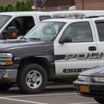 Elmira police vehicles.