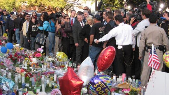 Gov. Jan Brewer visits memorial outside University