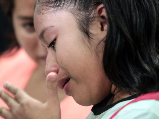 Yoselin Yamileth Velasquez Alemengor, 12, cries as