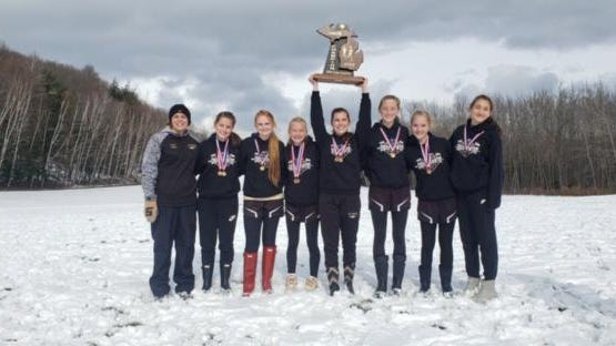 St. Ignace captured the Upper Peninsula Division 2 girls cross country championship Saturday. The Saints include, from left: coach Mary Cullen, Kylee Peters, Skylar Seccia, Wisteria Brady, Addison Cheeseman, Makayla Hess, Mariana Zaragoza and Haleigh Mattson.