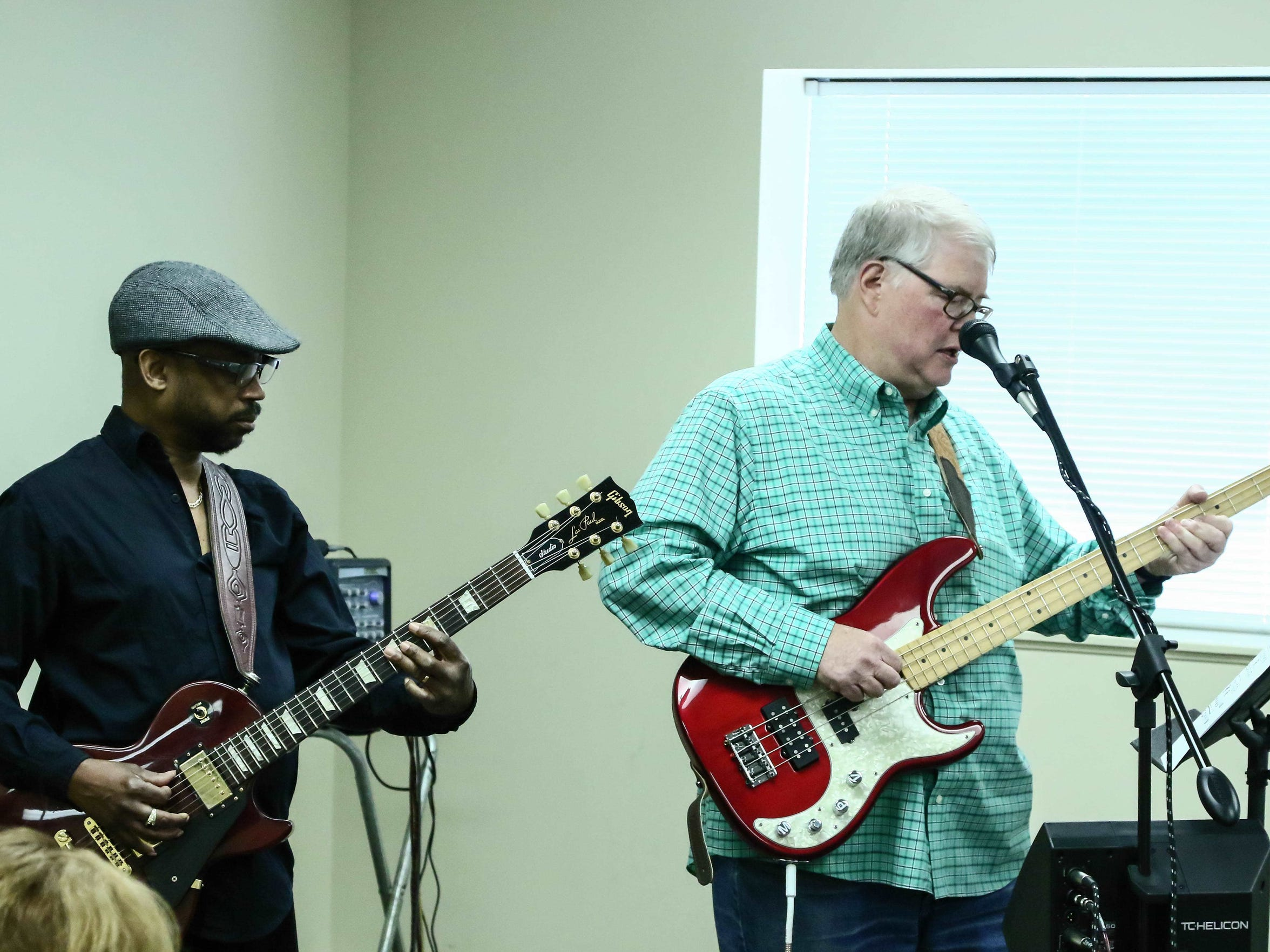 Stroke survivors Don Mann, right, and Lewis Lott, left, perform a guitar concert Friday, May 20, 2016.
