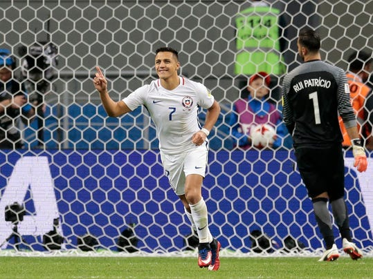 Chile's Alexis Sanchez celebrates after scoring a penalty past Portugal goalkeeper Rui Patricio, right, during the Confederations Cup, semifinal soccer match between Portugal and Chile, at the Kazan Arena, Russia, Wednesday, June 28, 2017. (AP Photo/Ivan Sekretarev)