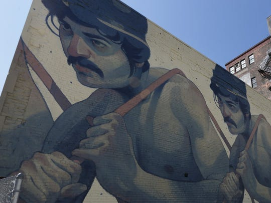 """""""One Man Army"""" a mural by Spanish artist Aryz on 25 East Grand River in Detroit."""