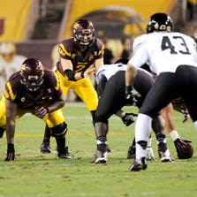 Mike Bercovici awaits the snap during the third quarter against the Colorado Buffaloes on Oct. 12, 2013, at Sun Devil Stadium in Tempe.