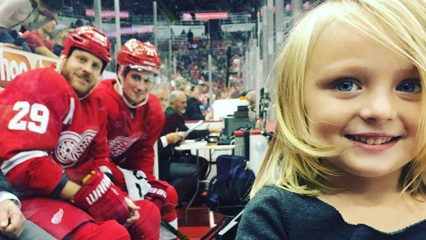 Shannon Almas took this photo of her daughter, Lylah, who was photobombed by Red Wings players Steve Ott, left, and Dylan Larkin on Oct. 2, 2016, during their preseason game at Joe Louis Arena.