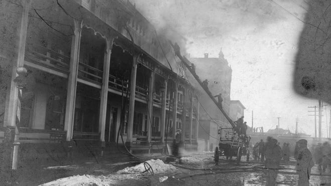 A fire at the Lewis House, located near the Exposition Hotel at 393 State St. in Binghamton, which caught fire on Feb. 5, 1901.