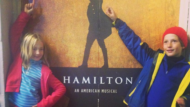 "Anne Hart's children in front of the Richard Rodgers Theatre in New York City when ""Hamilton"" was playing on Broadway with cost-prohibitive tickets."